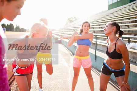 Teenagers Stretching at Race Track, Lake Oswego, Oregon, USA