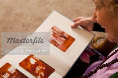 A senior woman looking at a photo album