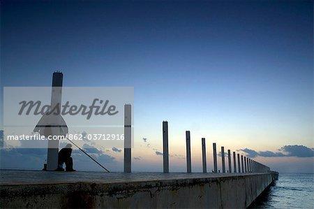 Playa del Carmen, Mexico. Watching the sun rise on the cruise ship dock in Playa del Carmen Mexico