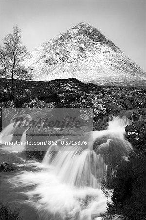 Coupall Falls and Buachaille Etive Mor in winter, Glencoe, Scotland, UK
