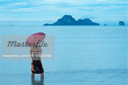 Woman with Umbrella on Nopparathara Beach, Krabi, Thailand