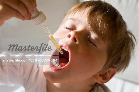 Boy Taking Medicine, Salzburg, Salzburger Land, Austria
