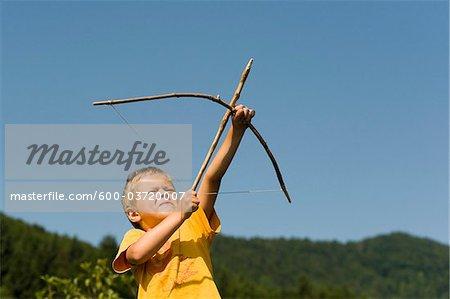 Boy Shooting Arrow, Salzburg, Salzburger Land, Austria