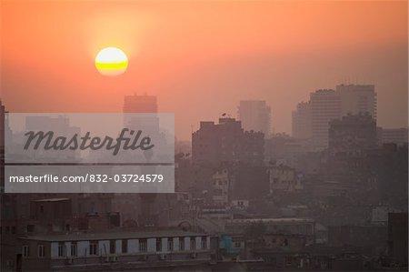 Minaret and blocks of flats at dusk
