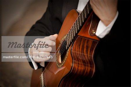 Close-Up of Guitarist Playing Guitar