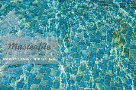 Blue Tiles at Bottom of Swimming Pool