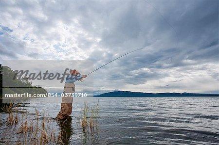Angler fly fishing in Bristol Bay at Crystal Creek King Salmon, Southwest Alaska, Summer