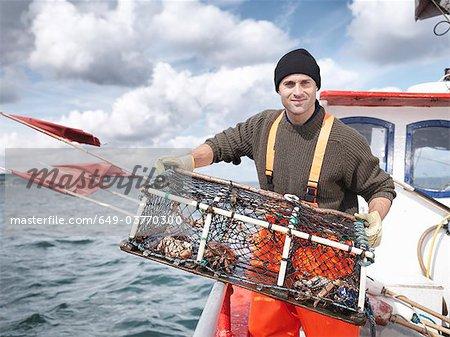 Pêcheur de homards et les crabes