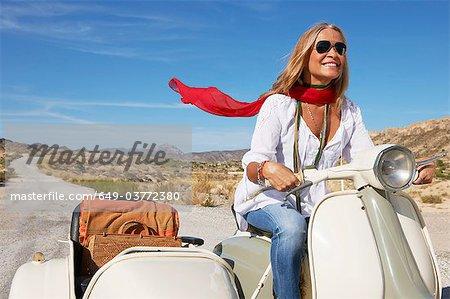 Woman riding on motorbike
