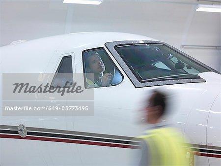 Engineer inspects jet cockpit