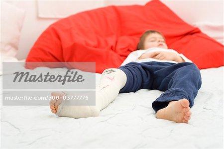 Boy with Cast on Leg Sleeping
