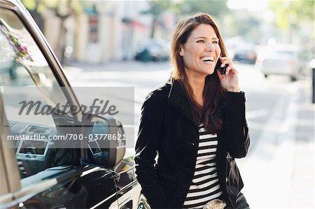 Woman Near Car Talking on Cell Phone