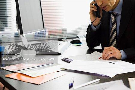 Executive talking on phone at desk