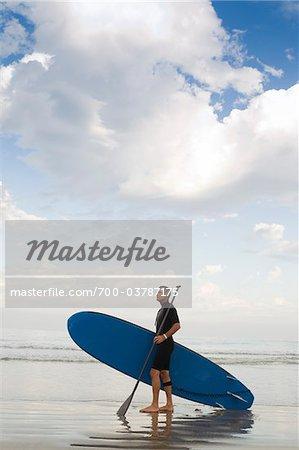 Paddleboarder at Beach