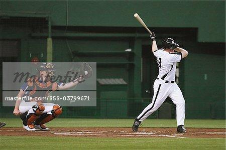 Players playing baseball game