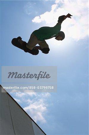 Japanese man skateboarding