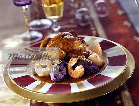 Quenelles de pommes de terre purée de caille avec langoustines et Vitelotte