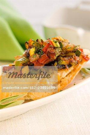 Vegetables on a bite-size slice of bread