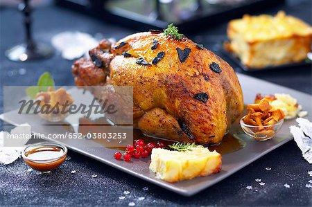 Roast guinea-fowl capon with Périgueux sauce