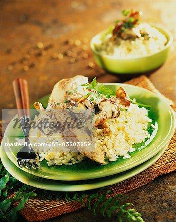Sliced turkey breast with mushroom risotto