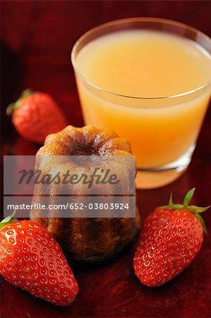 Cannelé,strawberries and grapefruit juice