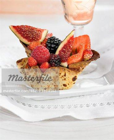 Small pastry basket full of summer fruit