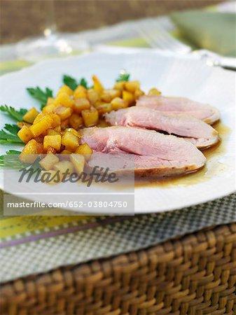 Sliced leg of lamb with sauteed potatoes