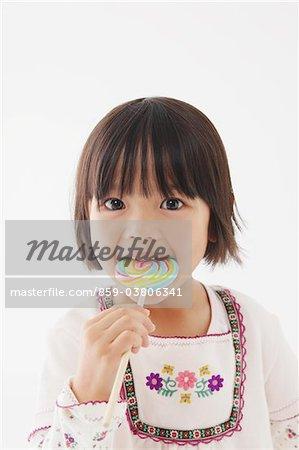 Japanese Girl eating lollypop