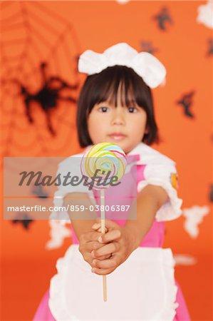 Japanese Girl Holding Lollypop