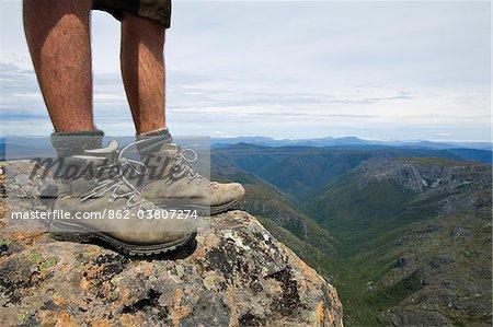 Australia, Tasmania, Cradle Mountain-Lake St Clair National Park.   Hiker standing on the summit of Cradle Mountain.