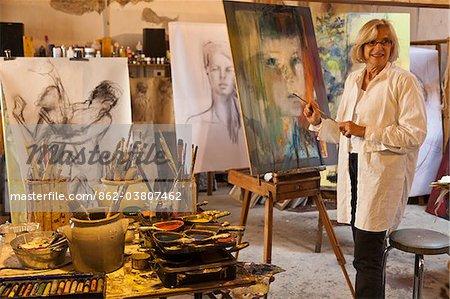 France, Tarn, Soreze.  Catherine Huppey in her artist's studio, L'Atelier du Pont Vaillant, Soreze.