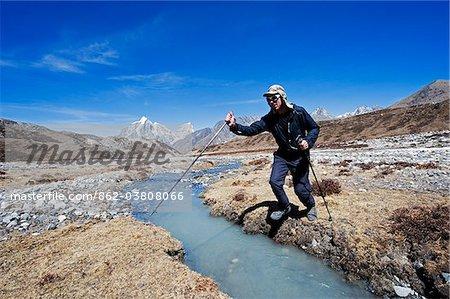Asia, Nepal, Himalayas, Sagarmatha National Park, Solu Khumbu Everest Region, Unesco World Heritage, Chukhung Valley, trekker at river crossing