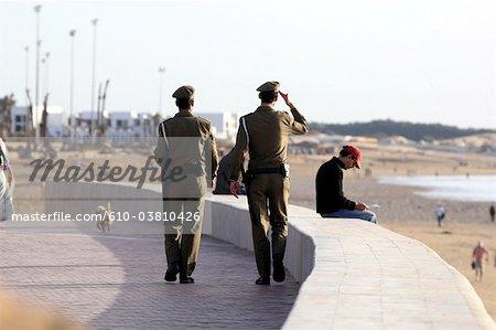 Morocco, Agadir, polecemen on patrol along the beach