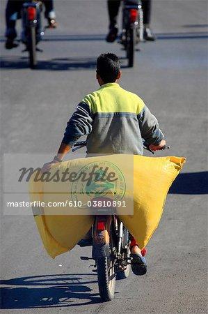 Morocco, Marrakech, carrying grains