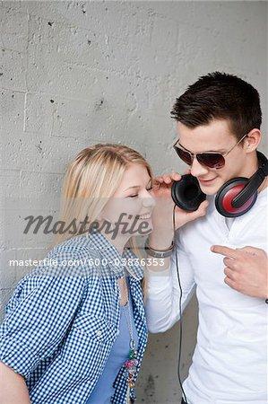 Teenagers Listening to Music