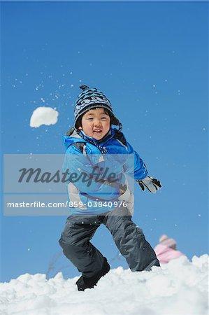 Boy Throwing Snow Ball