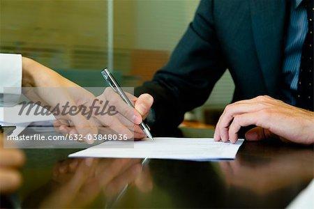Executive signing paperwork