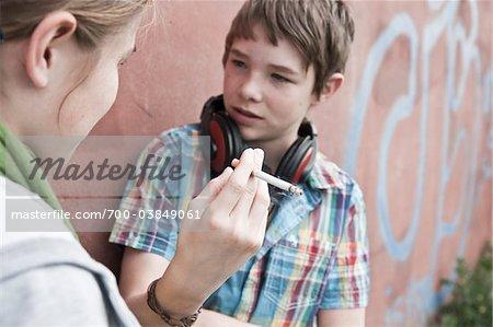 Young Teens Smoking Cigarettes