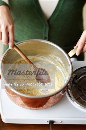 Woman Stirring Roux in Pot