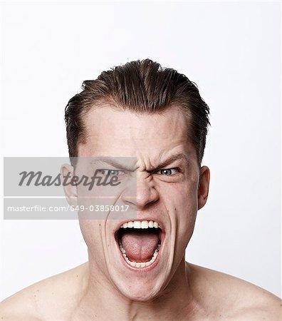 Nackten Mannes lustige Grimasse