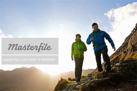 Men hiking on rocky mountainside