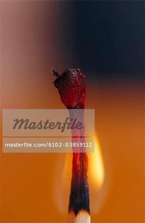 Close-up of flaming match stick