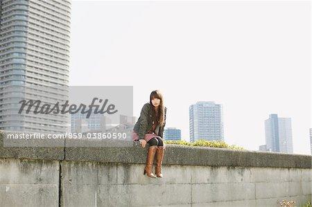 Women Sitting On Wall