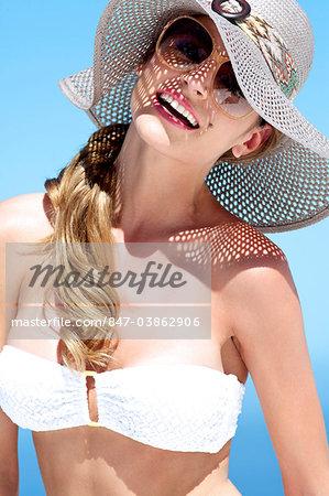 Portrait of beautiful brunette in the sun
