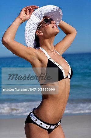 Beautiful brunette on the beach