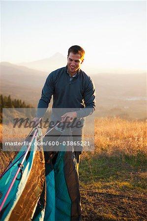 Man Setting Up Tent, Hood River, Oregon, USA