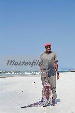 Fisherman with Catch on Beach, Zanzibar, Tanzania, Africa
