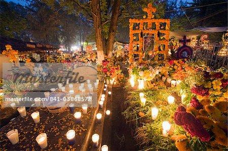 A candle lit grave, Dia de Muertos (Day of the Dead) celebrations in a cemetery in Tzintzuntzan, Lago de Patzcuaro, Michoacan state, Mexico, North America