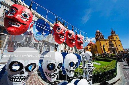 Masks for sale at a street market, Basilica de Nuestra Senora de Guanajuato, Guanajuato, UNESCO World Heritage Site, Guanajuato state, Mexico, North America