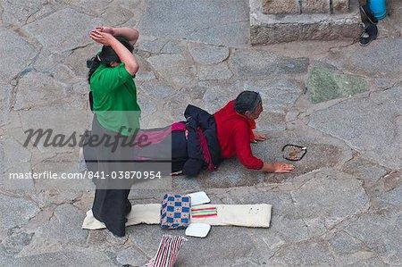 Pilgrims praying before the Jokhang Temple in Lhasa, Tibet, China, Asia